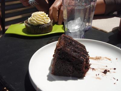 enjoying a piece of chocolate cake