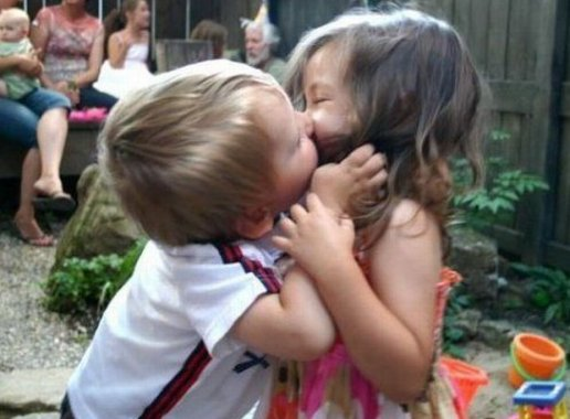 school girl and boy kiss