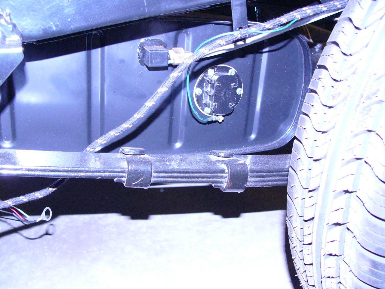 small resolution of the wiring harness has been installed as original here it s snuggled in with the battery cable fuel line and brake line using bend over tabs and p clips