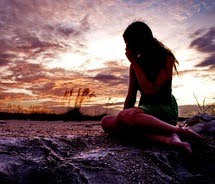 Woman alone at sunset