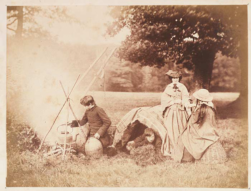 The Llewelyn Children. Photographer: John Dillwyn Llewelyn. Note: Other titles: 'Palmistry' also 'The Brewis Kettle' and 'Gipsies'. Figures l to r: John Talbot (Johnny) Dillwyn Llewelyn, Willy (in tent), Emma Charlotte DL seated on basket, Caroline Traherne (standing). Date: Probably September 6th, 1856. Medium: Print possibly taken from an oxymel negative.
