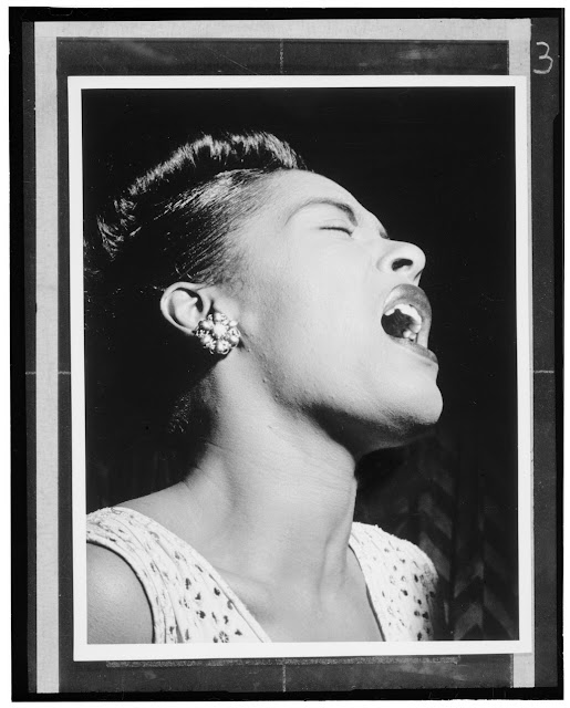Portrait of Billie Holiday, Downbeat, New York, N.Y., ca. Feb. 1947. Forms part of: William P. Gottlieb Collection (Library of Congress). In: The Record Changer, v. 5, no. 12 (Feb. 47, 1947), p. 7.