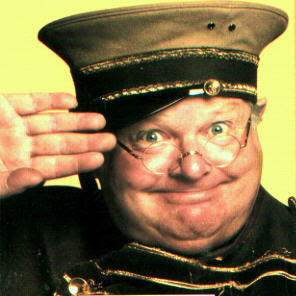 Benny Hill in character
