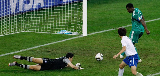 Yakubu Ayegbeni misses a scoring opportunity as South Korea goalkeeper Jung Sung-ryong lies on the pitch