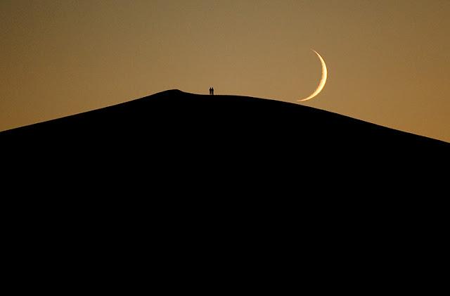 Moonrise over sand dunes, Gobi Desert, Mongolia.