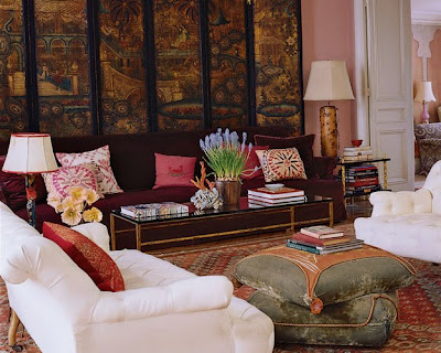 lisa fine paris living room with red sofa and antique chinese coromandel screen via belle vivir blog
