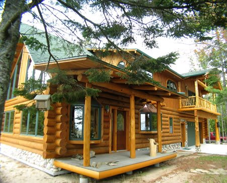 log home with green touch