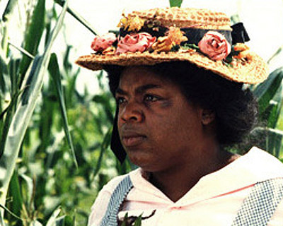 Characterize Sophia from The Color Purple. What effect does she have on Celie?