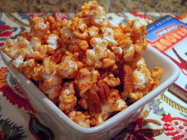 Cinnamon Caramel Corn - crazy addictive! Popcorn and pecans coated in a quick homemade cinnamon caramel sauce - brown sugar, cinnamon, corn syrup, butter, vanilla, and baking soda. Great snack or homemade gift. This always gets rave reviews! YUM!