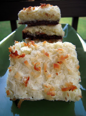 Black-Bottom Coconut Bars - homemade brownie base topped with sweet coconut topping. Reminded us of a mounds bar! SO good!! Butter, sugar, eggs, cocoa powder, flour, vanilla and coconut. Great for a potluck! #dessertrecipe #coconut #dessert