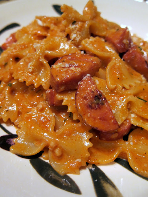 Creamy Jambalaya Pasta - seriously delicious! TONS of great flavor and it is ready in about 15 minutes. Pasta, smoked sausage, heavy cream, garlic, onion, cajun seasoning, paprika, white wine, tomato sauce and parmesan cheese. Better than any restaurant! Everyone RAVES about this easy pasta dish!!!