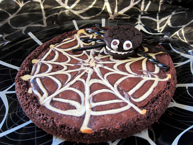 Spiderweb Brownies - transform boxed brownie mix into a super cute Halloween treat!! A quick homemade cheesecake mixture makes the spider web. Makes 2 brownies. SO fun!!! #Halloween #brownies #kidfriendly