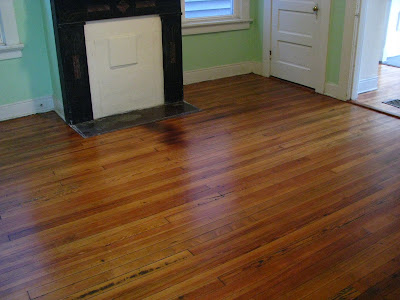 Remodelaholic | Refinished Wood Floors Previously Under Carpet