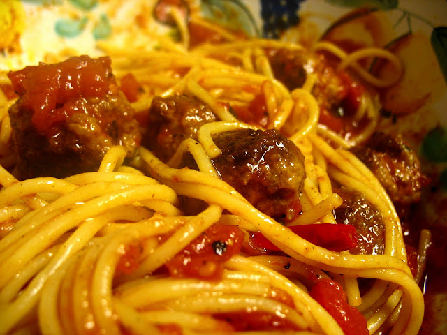 Calabrian spaghetti and meatballs served American style