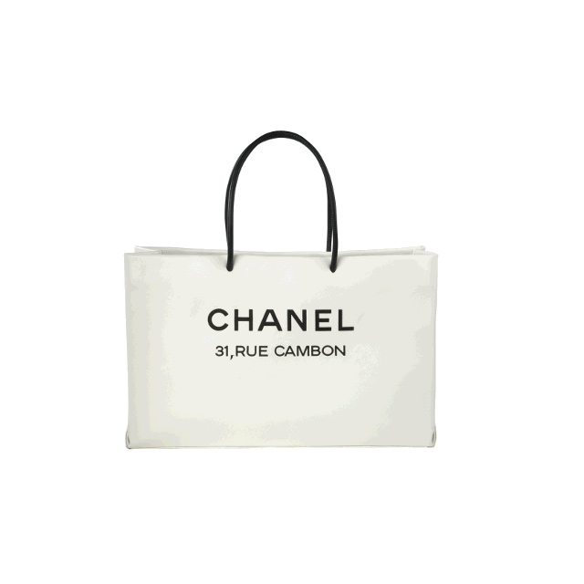 094a2976282b Its humorous and sort of makes a comment about the value of hand bags by  comparing a leather bag to the paper bag that lots of expensive stuff from  Chanel ...