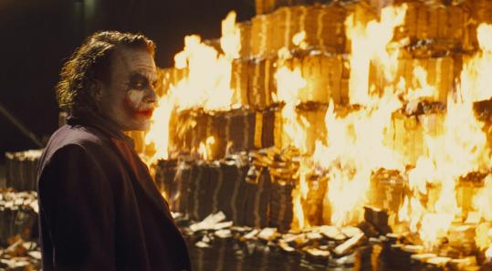 Joker burns money - Warner Brothers publicity still, with Heath Ledger as the Joker