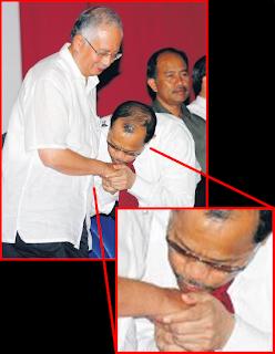 Tengok la ni~tafsirkan sendiri pemimpin kesayangan pencacai UMNO, bodek2!~.