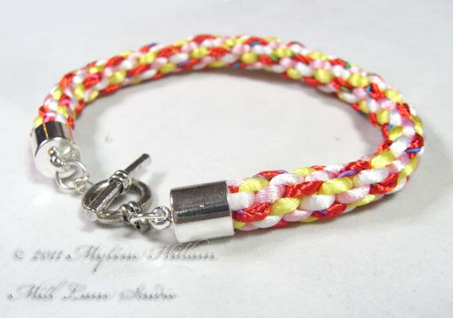 Kumihimo - a really fun way to braid! This straight forward tutorial will teach you the basics of how to make the braid and then how to turn it into a very pretty bracelet.