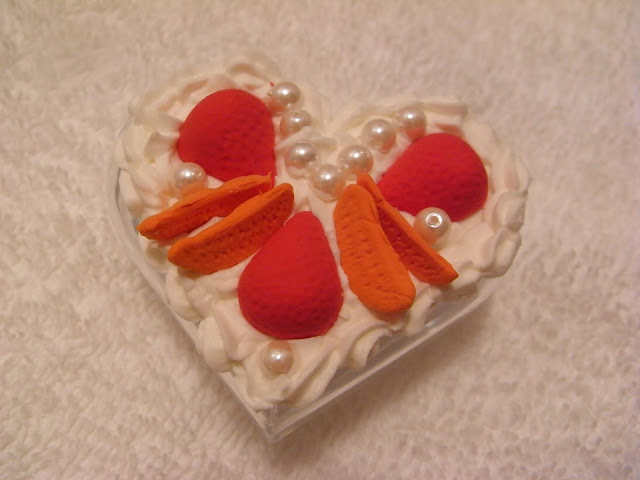Decoden-style clear acrylic heart-shaped box decorated with slices of polymer clay fruit