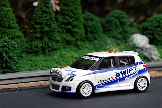 The Suzuki Swift Rally Car Night Version by Tomica