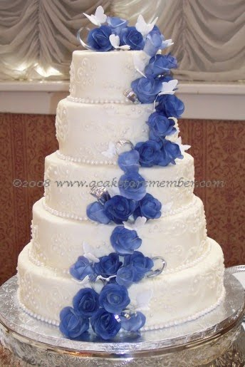 wedding cake with blue roses wedding accessories ideas 26830