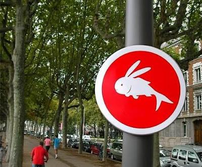 fish rabbit road sign