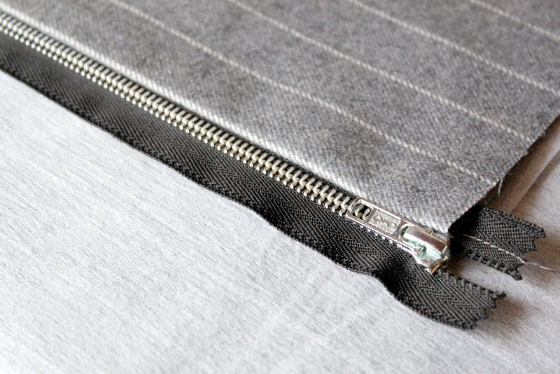 Turn fabric pieces right-side out and press seams open. Now do the exact  same thing with the other two pieces of fabric on the other side of the  zipper. 1ab39b20b233b