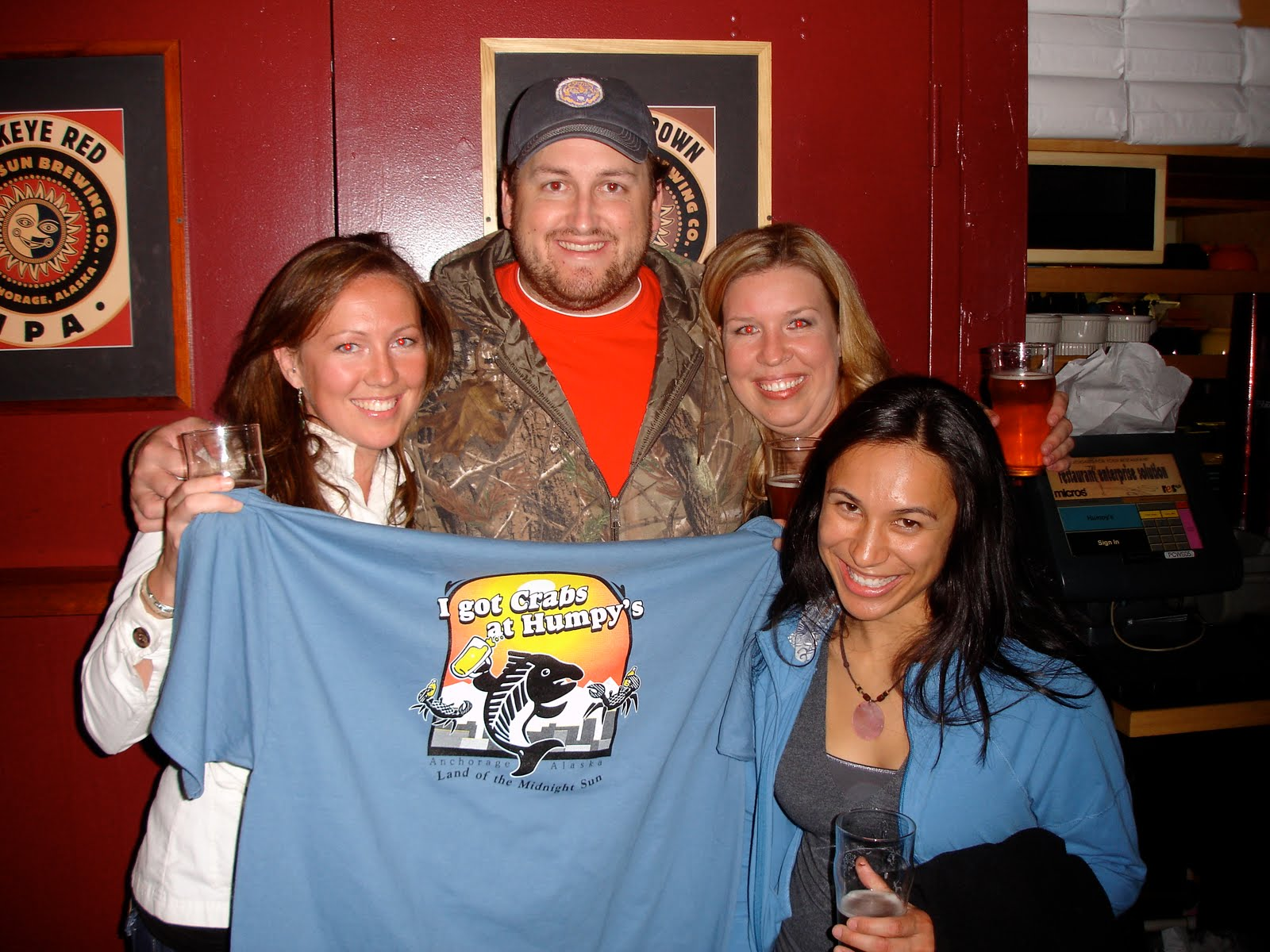 Jay poses with ladies in celebration of completing the kodiak arrest challenge