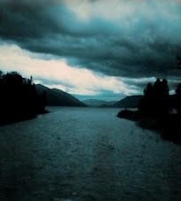 DARK CLOUDS OVER RIVER