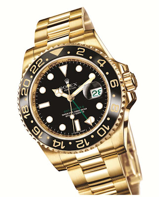 Rolex GMT-Master II 116718LN: 18 ct yellow gold case with black dial and black Cerachrom bezel insert.
