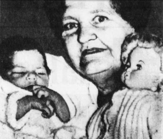Image: Joanna Du Plessis, 58, holds her baby Magda and one of her grandchildrens dolls. Mrs. Du Plessis had to borrow dolls clothing to dress the unexpected baby