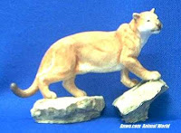 mountain lion figurine on rock