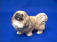 orange pekingese figurine sandicast