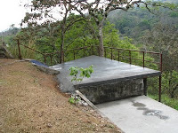 pool covered with concrete patio