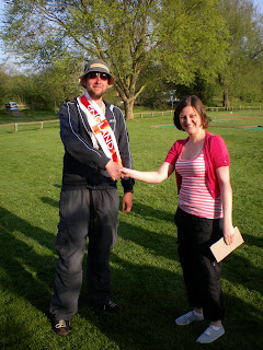 Photo: St George's Day Classic Champion Gareth Holmes receives his prizes from Emily Gottfried