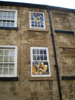 Civil War artwork on a building in Knaresborough