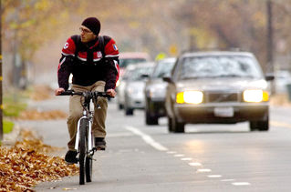 Image of bicyclist being overtaken by vehicles