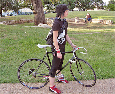 Image of woman with fixed gear bike