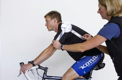 Image of a bicyclist being fitted on a bike