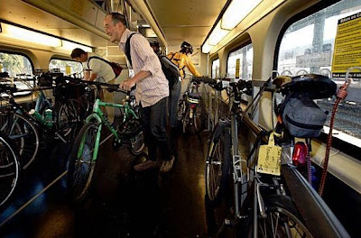 Image of bicyclists crowding onto Caltrain car