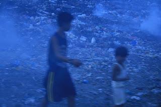 Children playing in Garbage Dump