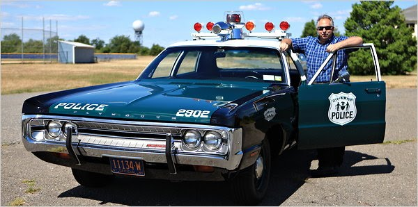 NYPD auxiliary officer creates history with restored police cars www