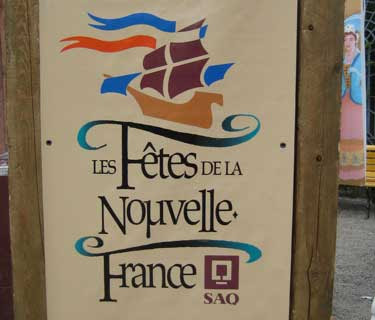 Stylized tall ship and the words La Fete de la Nouvelle France