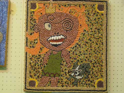 Cartoonish figure in beans and lentils