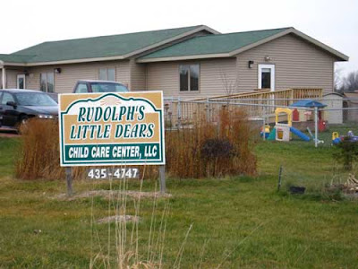 Child care business sign reading Rudolph's Little Dears
