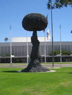 Black mushroom-shaped cloud sculpture