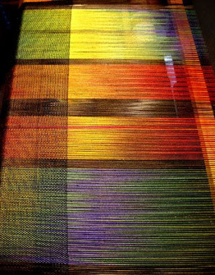 Ikat painted silk being woven