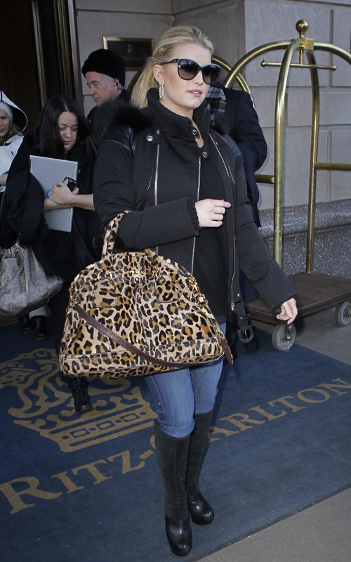 46671e7af5b3 Jessica Simpson has been in New York the last few days and, papped out and  about, her sunglasses have changed but she's toted her trusty Prada  Cavallino ...