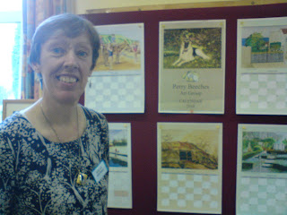 Jill Barnard with proofs of calendar
