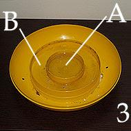 Il fondo della Covatutto ha due serbatoi per l'acqua.